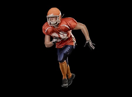 crouches: Professional american football player is running isolated Stock Photo