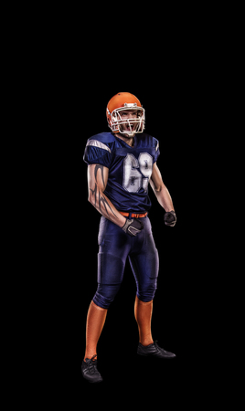 crouches: Professional young american football player on black background Stock Photo