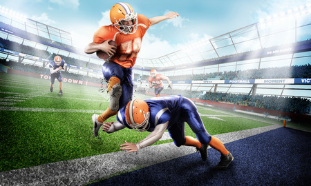 Professional american football players in the action on stadium