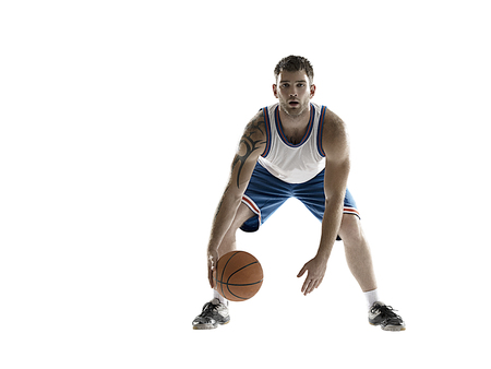 professional basketball player isolated on white with ball Stock Photo
