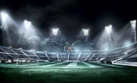 empty soccer stadium in light rays at night 3d illustration
