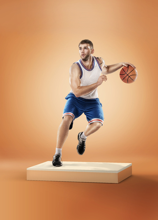 Basketball player in action on orange background