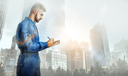 Portrait of manager on city background