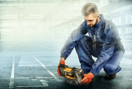 Portrait of a worker on factory background Banco de Imagens