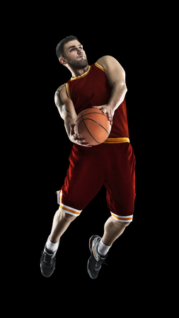one basketball player jump isolation Stock Photo