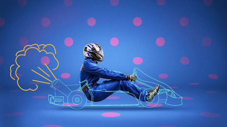 racer in painted racecar on polka-dot background Banco de Imagens - 94754066