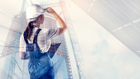 Portrait of builder in a helmet on city background Banco de Imagens - 96999666