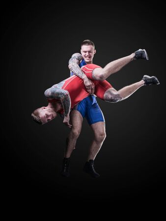 two wrestlers figting isolated on black back Banco de Imagens - 133413710