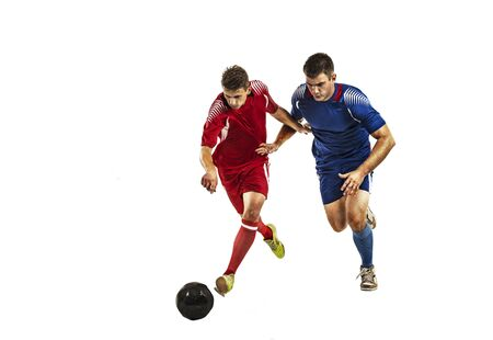 Soccer players in blue red uniform running with ball on white isolation Banco de Imagens - 133413730