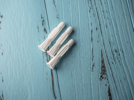 Plastic expansion on wooden blue background