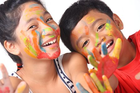 a young and happy kids with painted faces