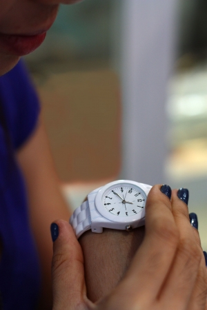 girl with a wristwatch: student checking time on her wrist watch shallow DOF