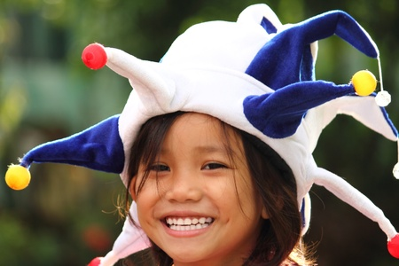 young asian girl wearing a clown hat