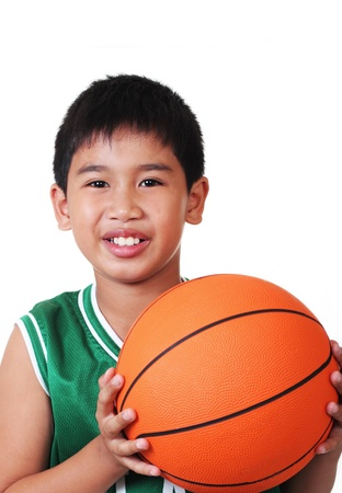 cute asian boy playing basketball in white background photo