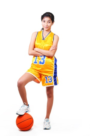 full body picture of a beautiful basketball player standing over a ball.white background 版權商用圖片 - 8736019