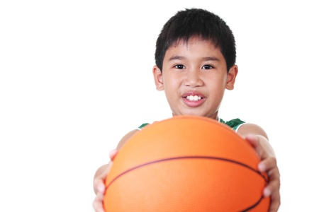 happy asian boy holding a ball photo