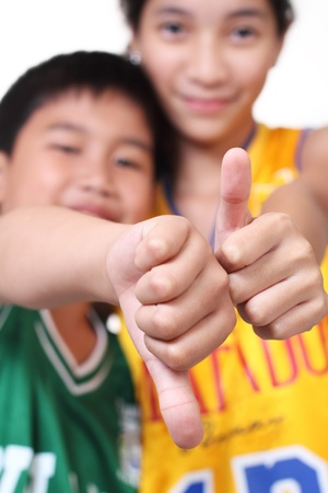 young basketball players making hands sign, focus on the hand photo
