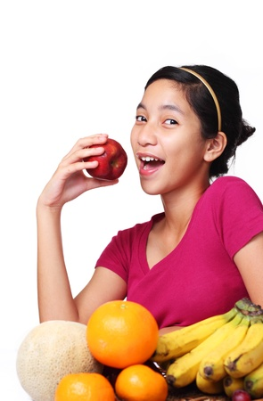 image of young lady about to eat Apple 版權商用圖片