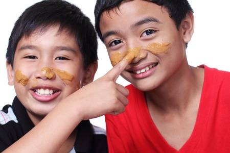 image of young boys with smeared faces 版權商用圖片