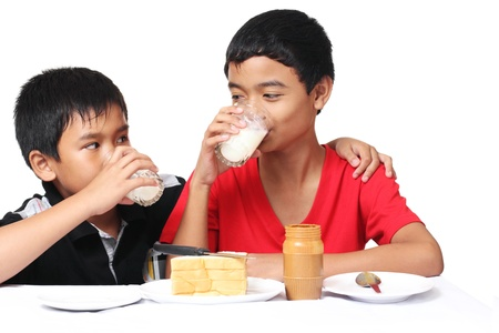 young asian boys drinking milk