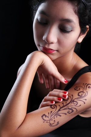 Portrait of young asian lady with tattoo  photo