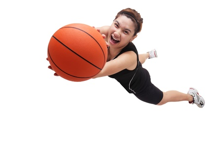 teens playing: Image of a jumping lady basketball player