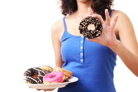 dough nut: lady showing a bunch of delicious donut