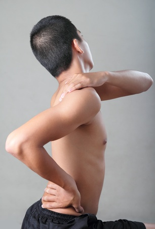 sore muscles: Young man with body pain