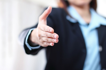 Close up image of a businesswoman's hand offering handshake.