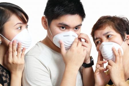 disease prevention: Retrato de la gente con una m�scara de protecci�n Foto de archivo