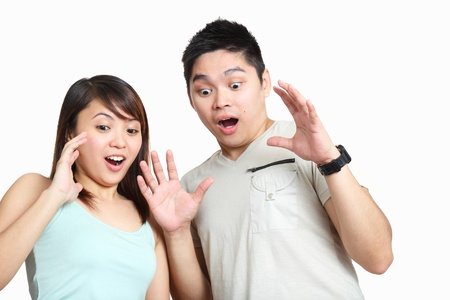 Couple showing surprised or amazed expression.