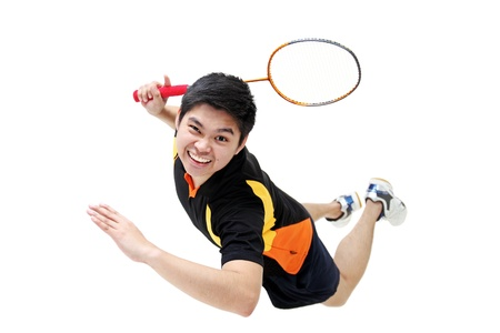 Jumping badminton player isolated in white background. 版權商用圖片