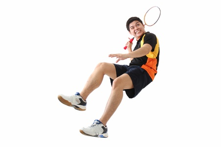 Young male badminton player in action.Isolated in plain background.