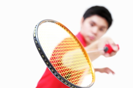 Badminton player showing his racket. Narrow depth of field.