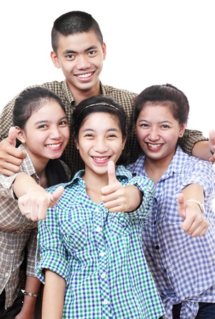 Happy group of asian teenagers making thumbs up sign. Stock Photo - 12614732