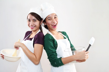 woman baking: Young happy asian female bakers