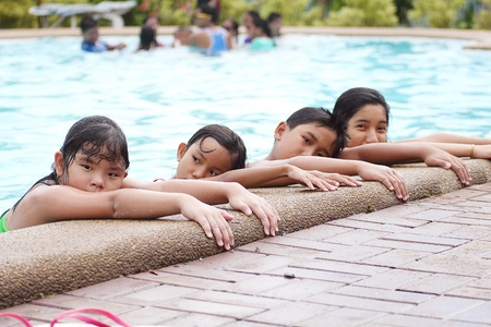 lining up: Asian children lining up at the pool side. Stock Photo