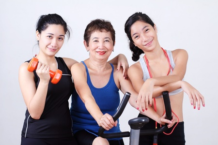 Grandmother working out with young ladies.