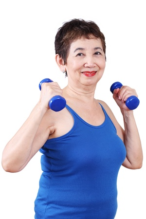 pensioner: Elderly woman exercising with dumbbell.
