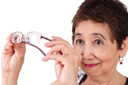 Senior woman with poor eyesight checking her eyeglasses.