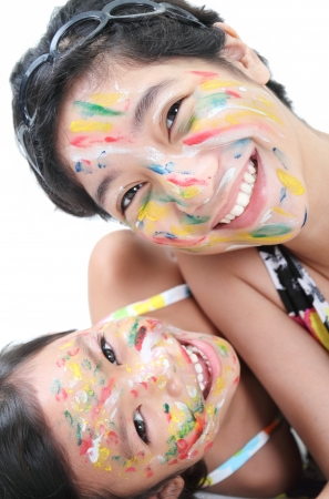 Happy asian girls with painted faces