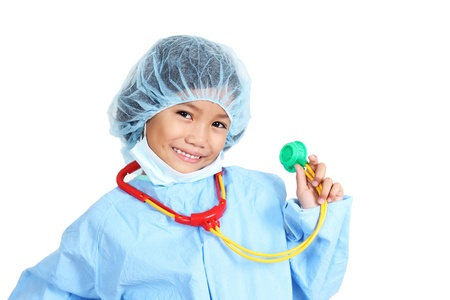 Young girl wearing a surgeons operating suit and holding a toy stethoscope.