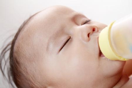 Sleeping baby boy while on bottle feeding.Close ujp. Stock Photo - 14838999