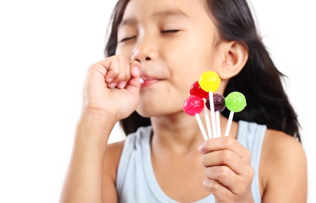 Portrait of a girl eating a lollipop. photo