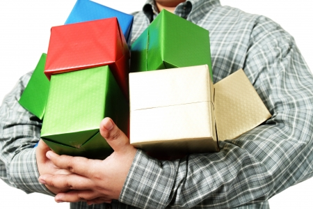 Close up of gift boxes in businessmans arm.  photo