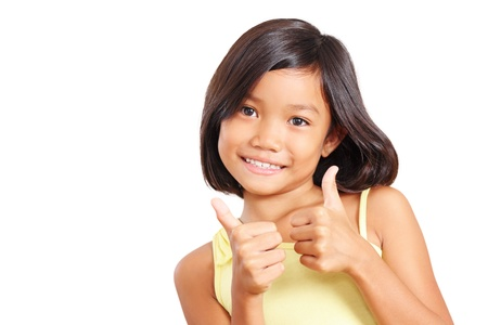 Young beautiful girl making two hands thumbs up. Isolated in white background.