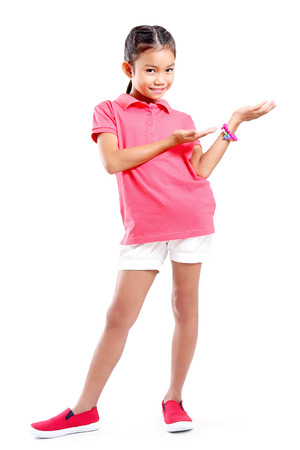 Full body shot of a young girl introducing something