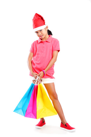 body image: Full body image of a young asian girl with shopping bag  Isolated in white background  Stock Photo