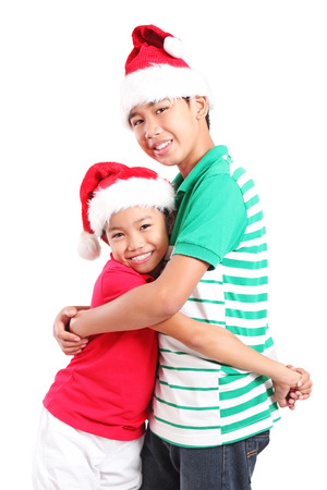 Happy young friends hugging at christmas. Isolated in white background. photo
