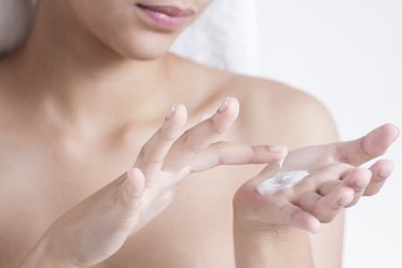 cosmetic cream: Close up of hands with skin lotion.